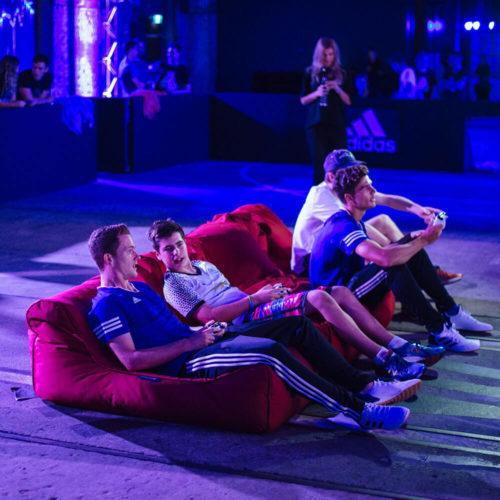 players enjoy the Sydney Adidas Tango League FIFA games with studio lounger bean bags