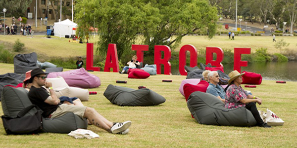 La Trobe University lawn launch 50th celebration with bean bags on the lawn area