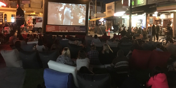 bean bags added to enjoyment of guest on pop up cinema in Acland Village, Melbourne
